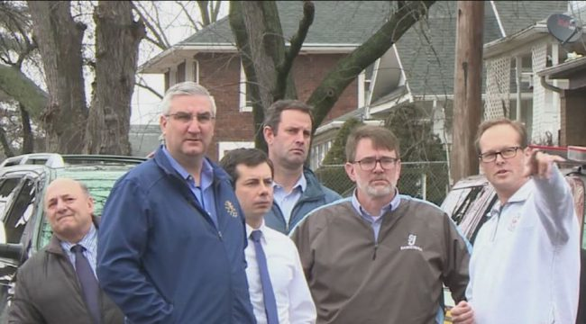 Gov. Eric Holcomb is joined by South Bend Mayor Pete Buttigieg to survey flood damage on Feb. 23, 2018. (Provided Photo_WBND)_831143
