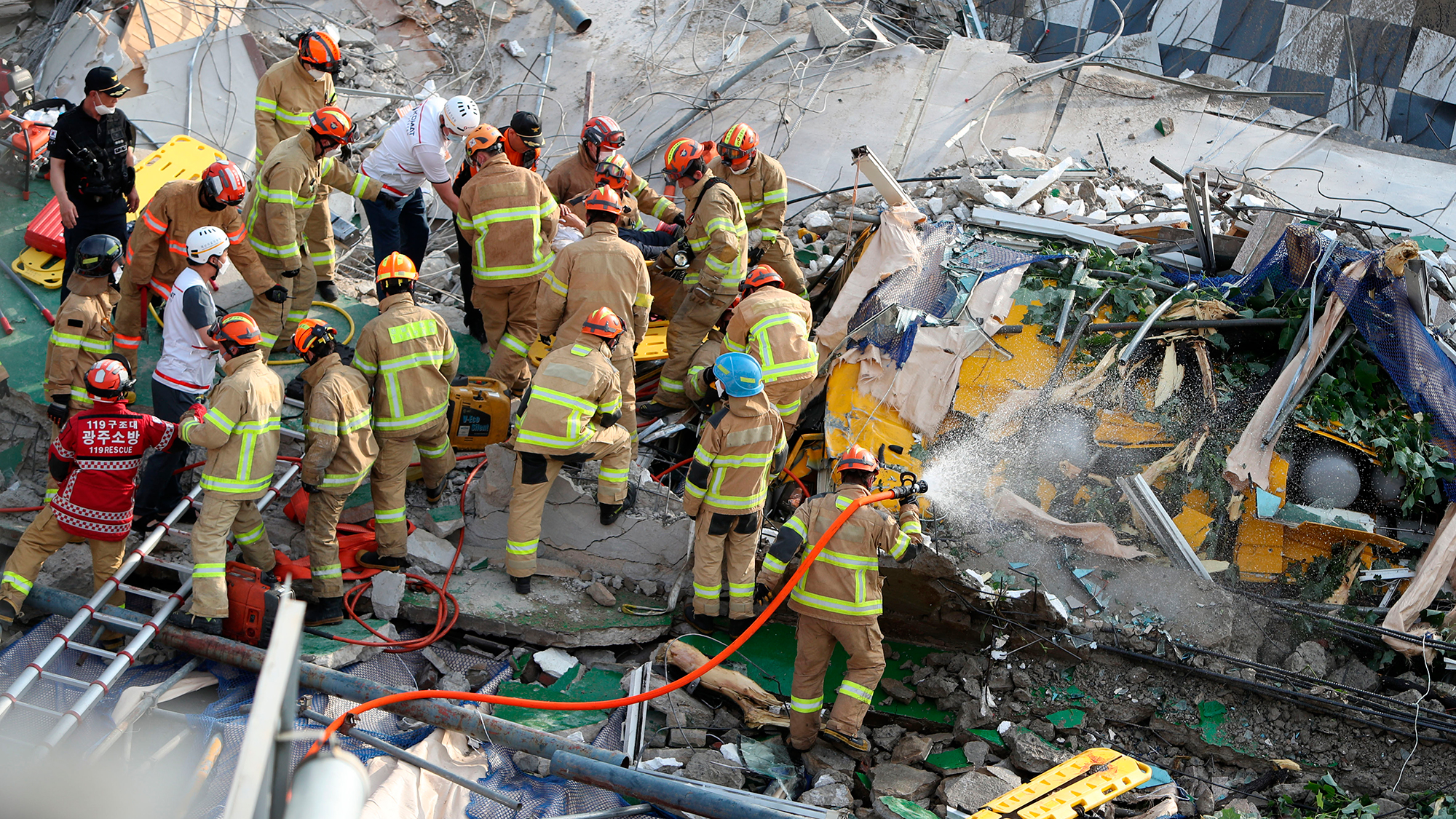 South Korea building collapses onto bus during demolition, killing 9 - WISH-TV