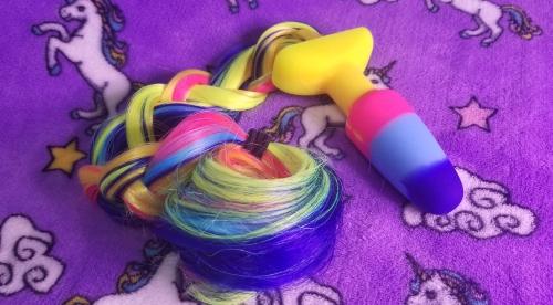 Rainbow Unicorn Tail Plug braided for storage.