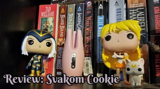 Svakom Cookie sitting on a bookshelf near Pop figures