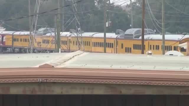 Train carrying casket leaves suburban Houston