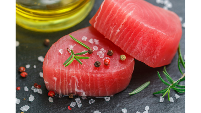 Raw Tuna Fish Steaks With Sea Salt, Pepper And Rosemary For Gril_1555522626315