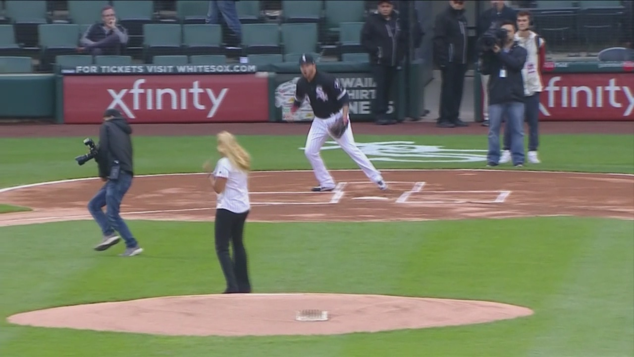 Photographer hit by first pitch