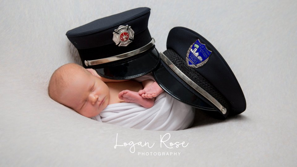 Jacksonville couple takes newborn pictures with firefighter hat