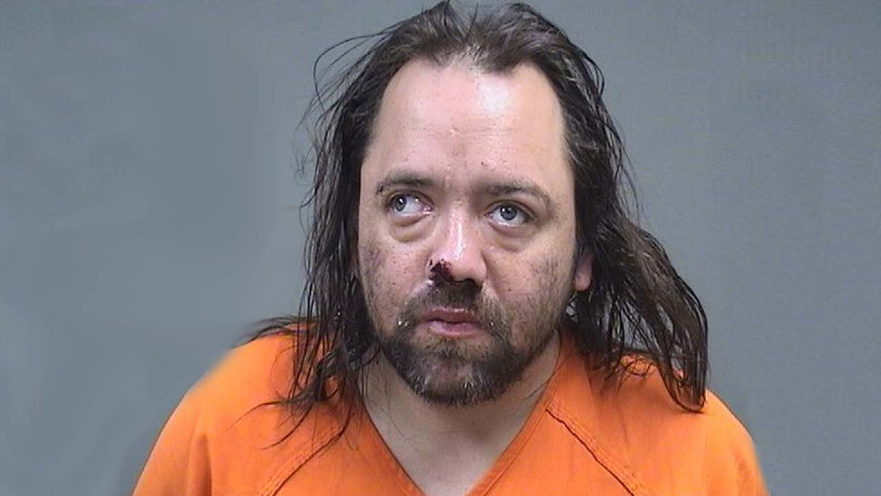 Justin Stamp, charged with menacing by stalking in Struthers.