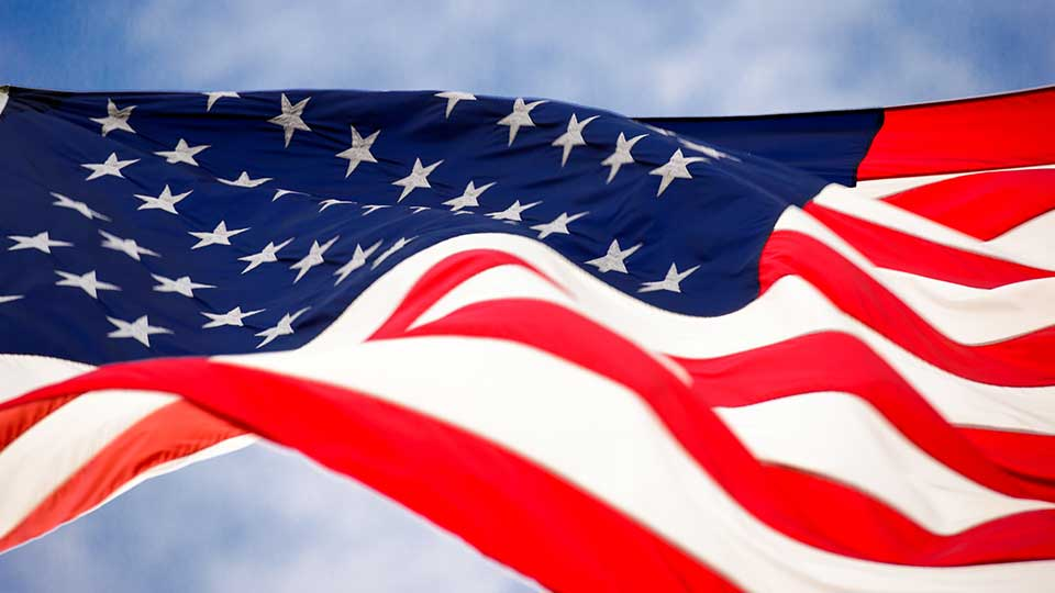 An American flag waving in the air above.