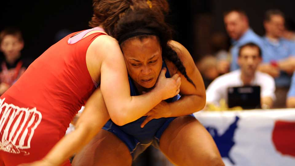 Two women competing in a wrestling match.