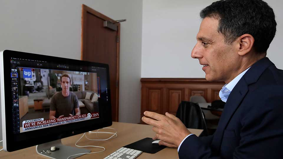 "In this Monday, July 1, 2019, photo Hany Farid, a digital forensics expert at the University of California at Berkeley, studies a video clip of Facebook CEO Mark Zuckerberg in his office in Berkeley, Calif. Sophisticated phony videos called deepfakes have attracted attention as a possible threat to election integrity. But a bigger problem for the 2020 U.S. presidential contest may be ""dumbfakes."""