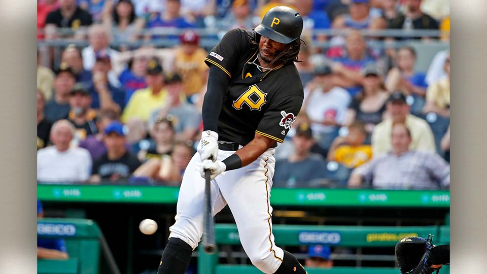 Pittsburgh Pirates' Josh Bell drives in a run with a sacrifice fly off Chicago Cubs starting pitcher Kyle Hendricks during the first inning of a baseball game in Pittsburgh.