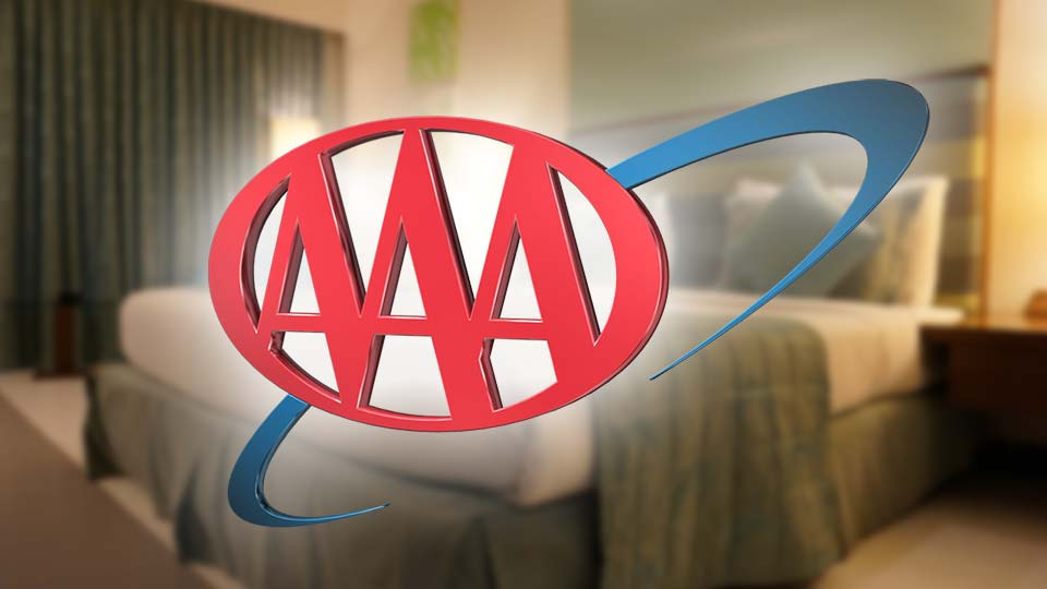 The AAA logo in front of a hotel room.