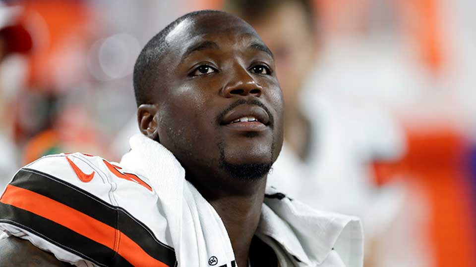 FILE - In this Aug. 8, 2019, file photo, Cleveland Browns defensive end Chris Smith (50) sits on the sideline during the first half of an NFL preseason football game against the Washington Redskins in Cleveland. Petara Cordero, the girlfriend of Smith has been killed in an accident early Wednesday, Sept. 11, 2019. The team said Cordero, 26, died when she was struck by an oncoming car on I-90 West at around 2 a.m. after she and Smith had pulled to the side of the road when the car he was driving had a tire malfunction and spun out.