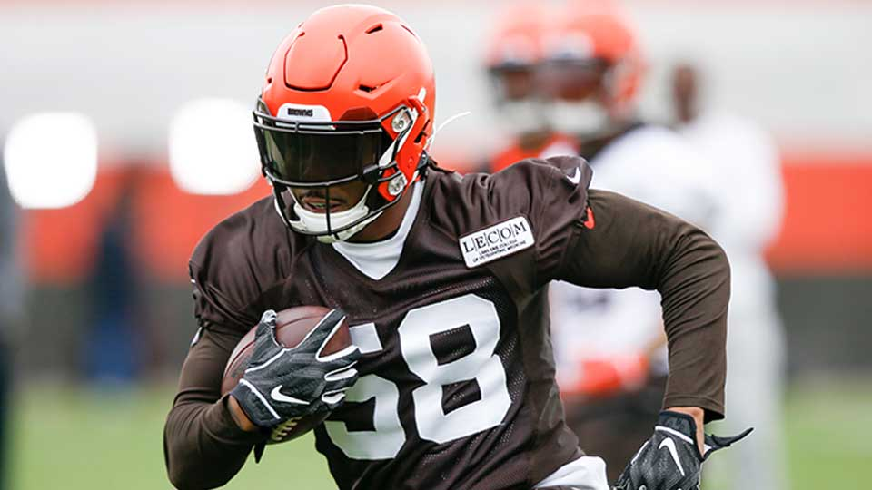 Cleveland Browns' Christian Kirksey returns an interception during an NFL football organized team activity session at the team's training facility Wednesday, May 22, 2019, in Berea, Ohio.