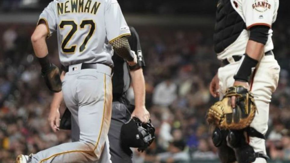 Pittsburgh Pirates' Kevin Newman (27) scores a run past San Francisco Giants catcher Stephen Vogt, right, on a single by Colin Moran during the fifth inning of a baseball game Wednesday, Sept. 11, 2019, in San Francisco.