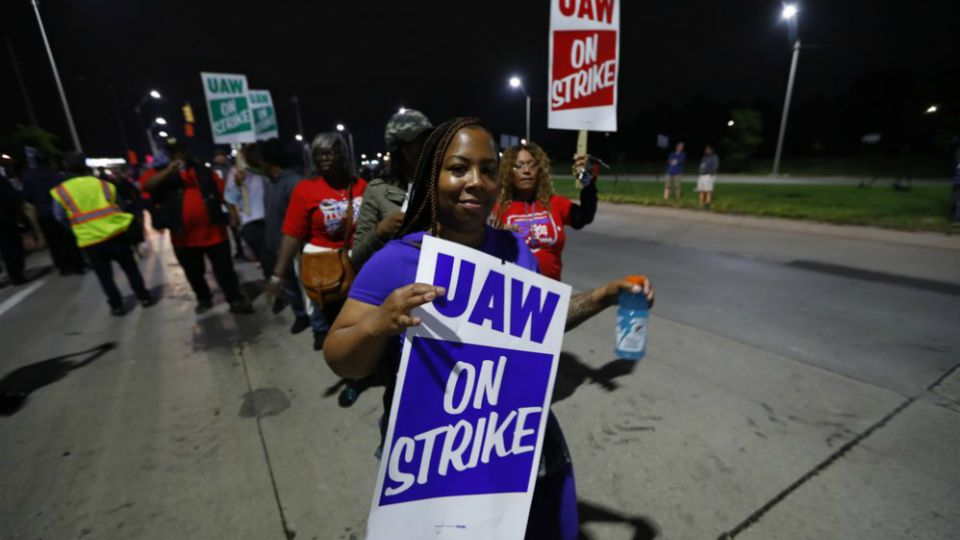 United Auto Workers members picket outside the General Motors Detroit-Hamtramck assembly plant in Hamtramck, Mich.