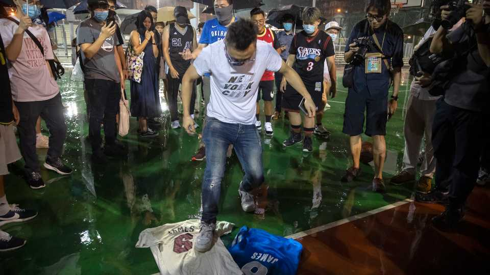 A demonstrator stomps on Lebron James jerseys during a rally at the Southorn Playground in Hong Kong, Tuesday, Oct. 15, 2019. Protesters in Hong Kong have thrown basketballs at a photo of LeBron James and chanted their anger about comments the Los Angeles Lakers star made about free speech during a rally in support of NBA commissioner Adam Silver and Houston Rockets general manager Daryl Morey, whose tweet in support of the Hong Kong protests touched off a firestorm of controversy in China
