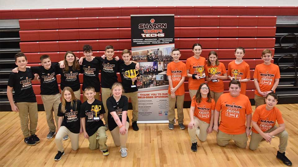 Tiger Techs Team Orange and Team Black take a moment to celebrate after a weekend of competing at the Western Pennsylvania FIRST LEGO League (FLL) Championship at Sewickley Academy, Pittsburgh. The Techs earned the top two awards, First and Second place Champions Award, qualifying both teams to advance to two world events. Pictured from left to right; bottom row- Camryn Taneri, Ian Fischer, Katelyn Powell, Dani Currie, Tony Gaggini, Matthew Schimp; back row (left to right) Bodhi Paknis, Lucas Province, Mary Brown, Warren Hackett, Keegan Widmyer, Ben Pollock, Jack Hynes, Kaytlen Moroney, Abbey Baron, Kayden Moroney, and John Stanek.