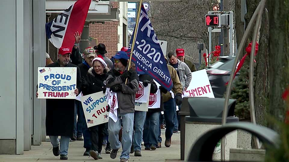 A group of supporters of President Donald Trump took a message to Congressman Tim Ryan's local offices in downtown Youngstown.