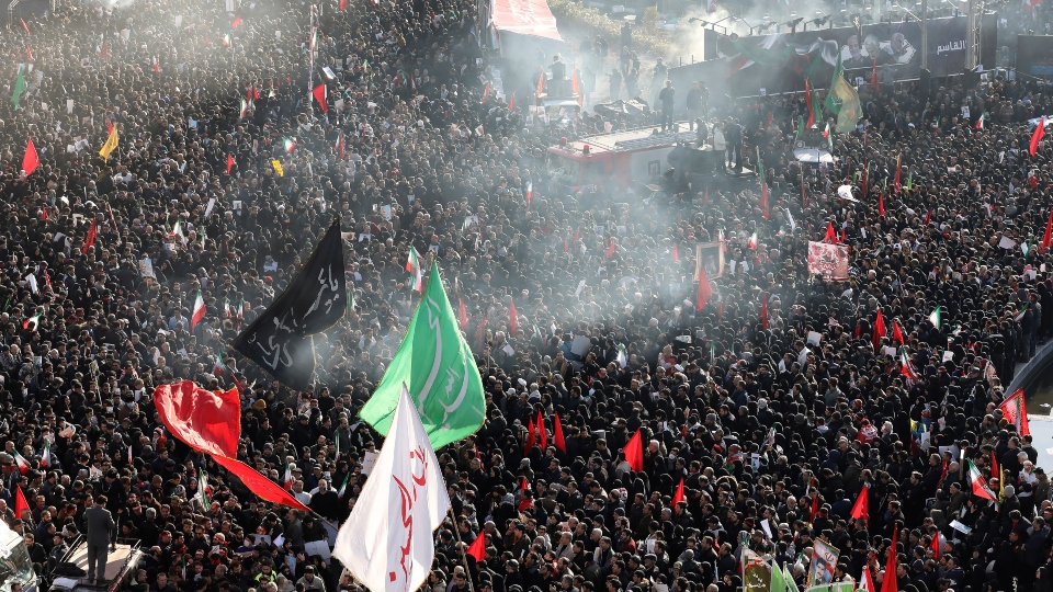 Mourners attend a funeral ceremony for Iranian Gen. Qassem Soleimani and his comrades, who were killed in Iraq in a U.S. drone strike on Friday, at the Enqelab-e-Eslami (Islamic Revolution) square in Tehran, Iran.