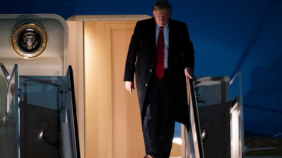 President Donald Trump exits Air Force One on Wednesday, Jan. 22, 2020, at Andrews Air Force Base, Md., after returning from the World Economic Forum in Davos, Switzerland.