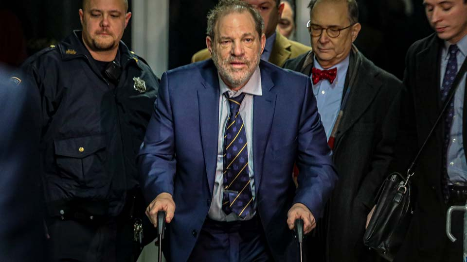 Harvey Weinstein, second from left, leaves Manhattan's Criminal Court