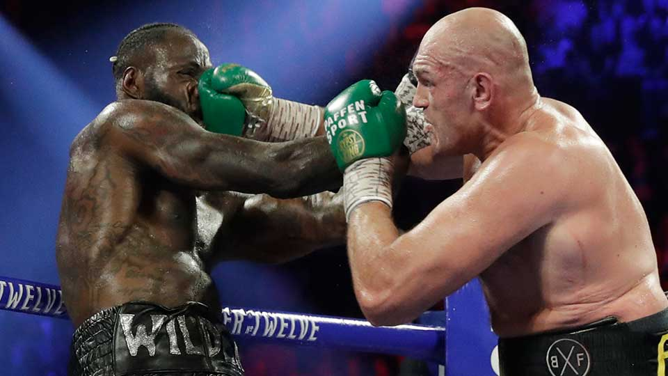 Tyson Fury, of England, lands a right to Deontay Wilder during a WBC heavyweight championship boxing match Saturday, Feb. 22, 2020, in Las Vegas.