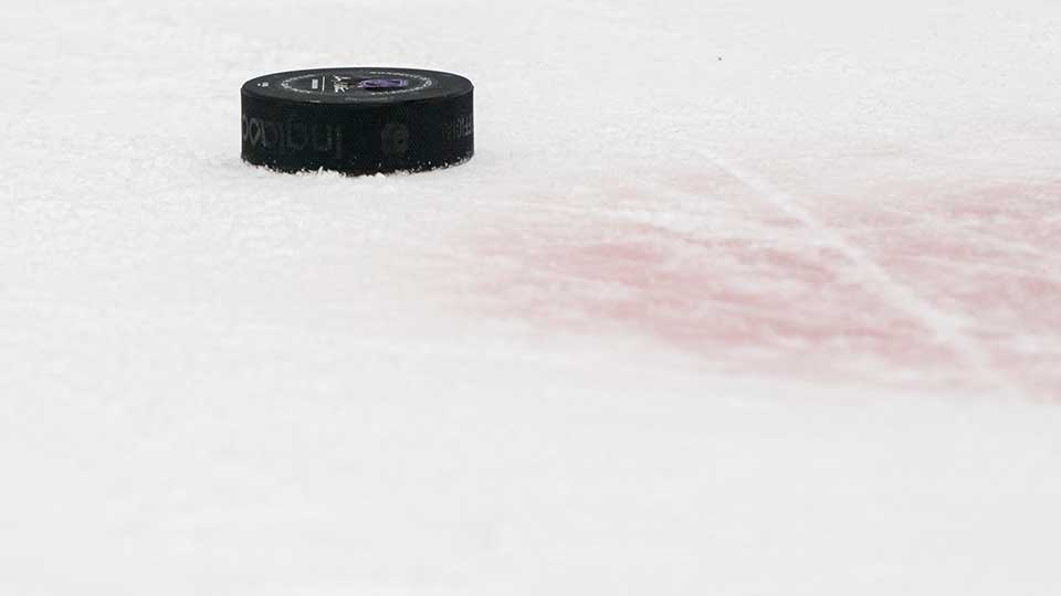 A puck sits on the ice during NHL action between the Vancouver Canucks and the Boston Bruins at Rogers Arena on February 22, 2020 in Vancouver, Canada.