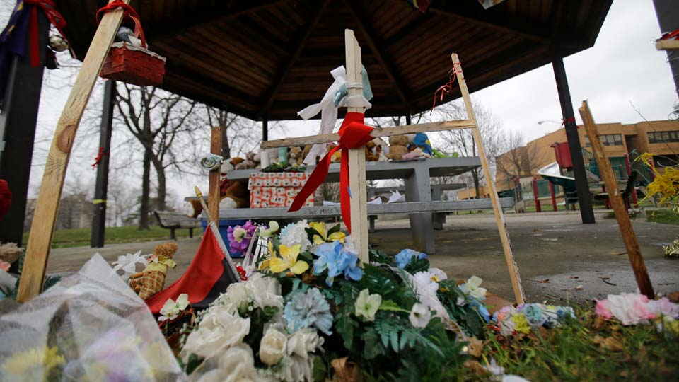 A memorial for Tamir Rice rests on a picnic table outside the Cudell Recreation Center