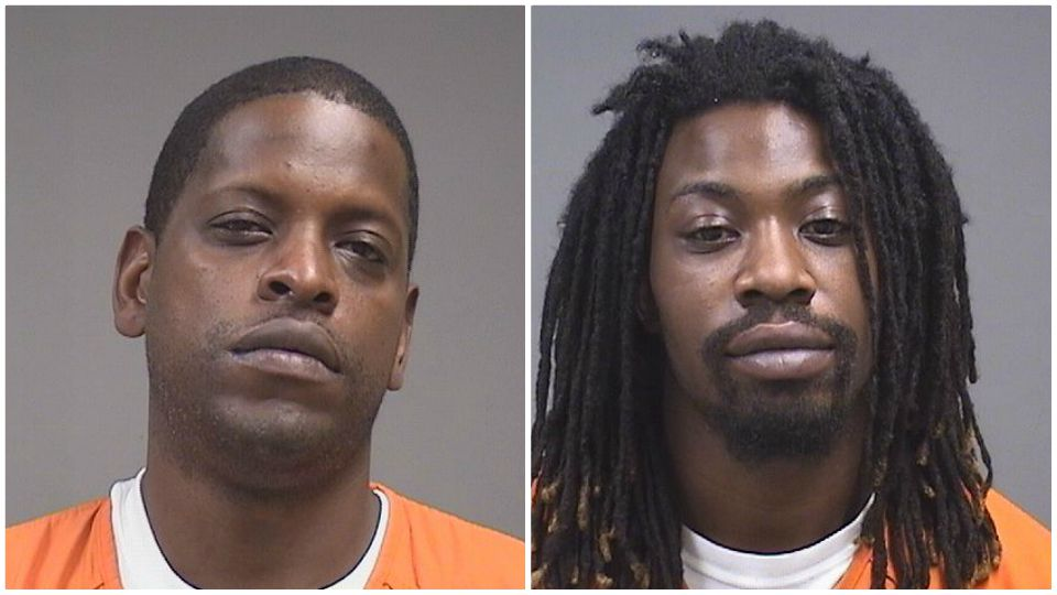 Two men were arrested by U.S. Marshals Wednesday in connection to the death of a man found inside a burning SUV. Now, their booking photos have been released.