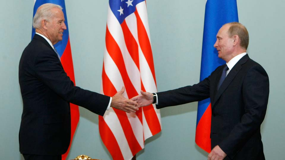 Vice President of the United States Joe Biden, left, shakes hands with Russian Prime Minister Vladimir Putin in Moscow, Russia