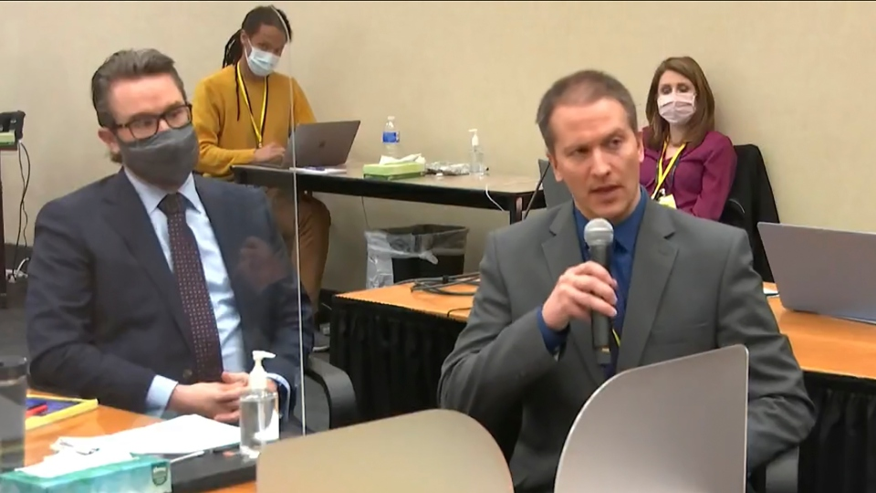 In this image from video, defense attorney Eric Nelson, left, and defendant, former Minneapolis police officer Derek Chauvin address Hennepin County Judge Peter Cahill during motions before the court.