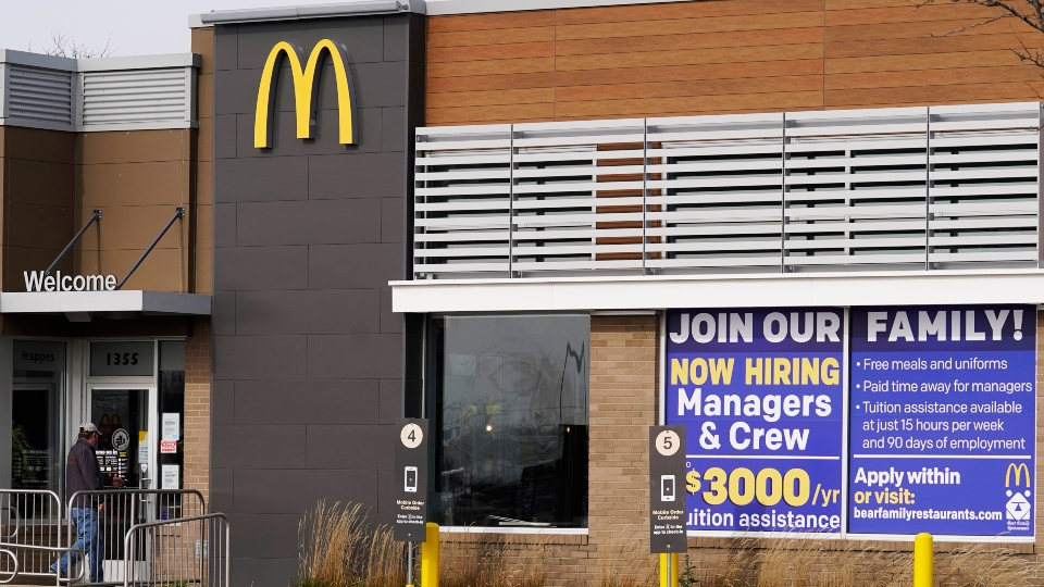 In this Nov. 19, 2020, file photo, a hiring sign is displayed outside of McDonald's in Buffalo Grove, Ill.