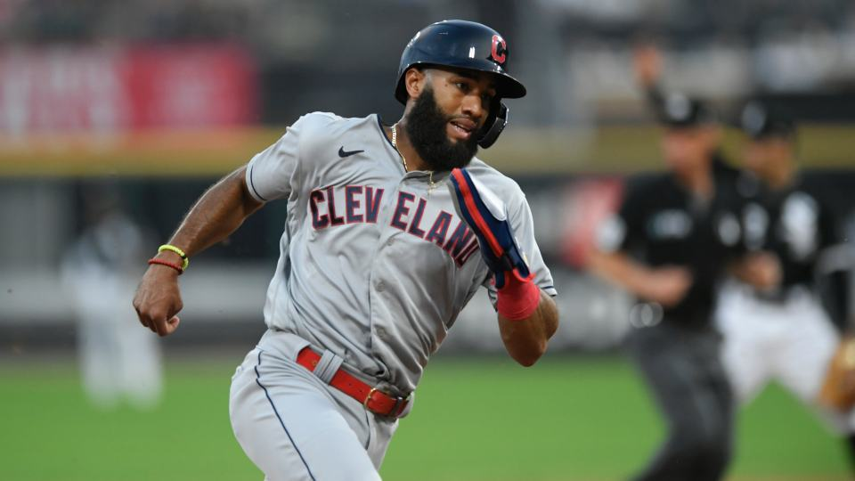 Cleveland Indians' Amed Rosario rounds third base before scoring on a Franmil Reyes double during the sixth inning of the team's baseball game against the Chicago White Sox on Saturday, July 31, 2021, in Chicago. (AP Photo/Paul Beaty)