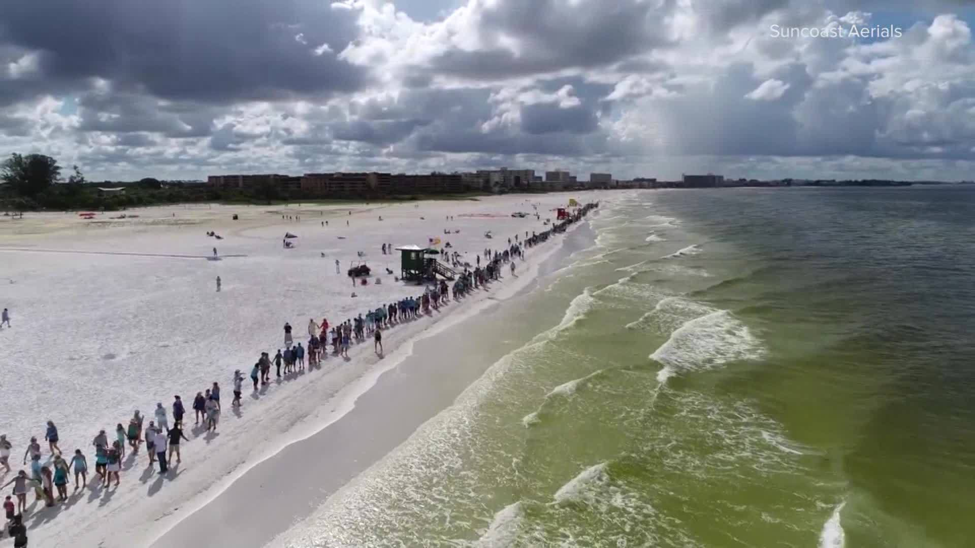 'Hands Along the Water' events were held along the coast Sunday morning