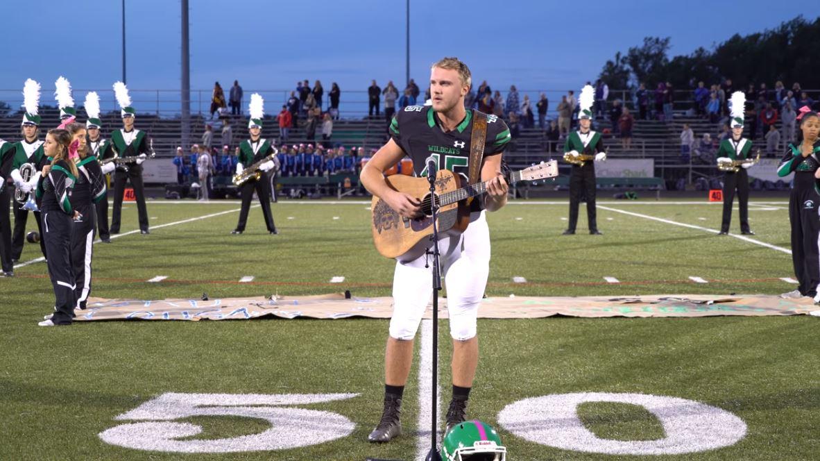 teen sings national anthemn_1540330927080.JPG.jpg