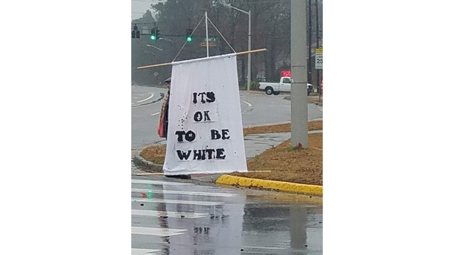 its ok to be white sign toni klemmer photo_1549906254968.jpg_72367869_ver1.0_640_360_1549996946546.jpg.jpg