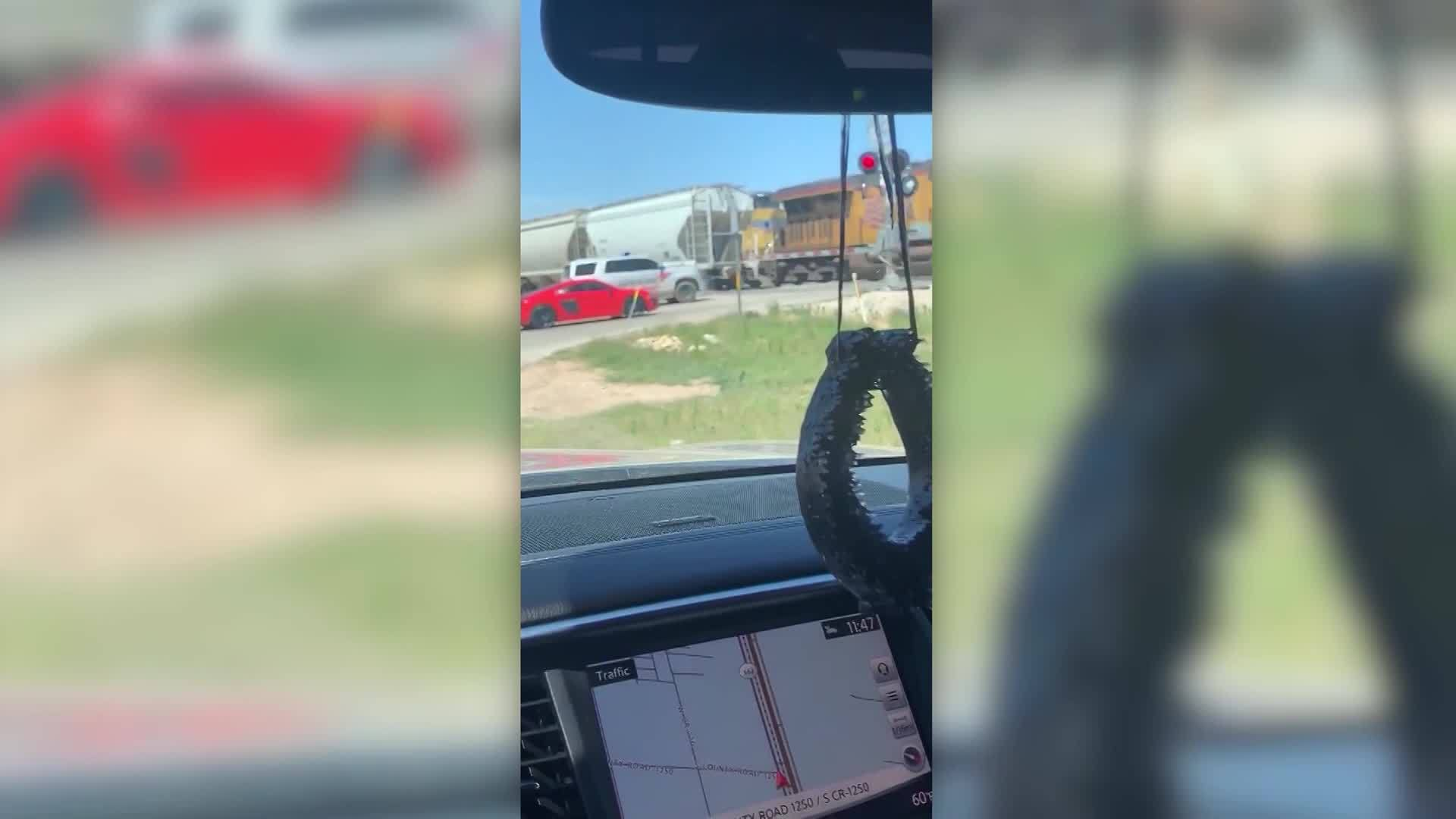 Caught on camera: Deputy's vehicle hit by train