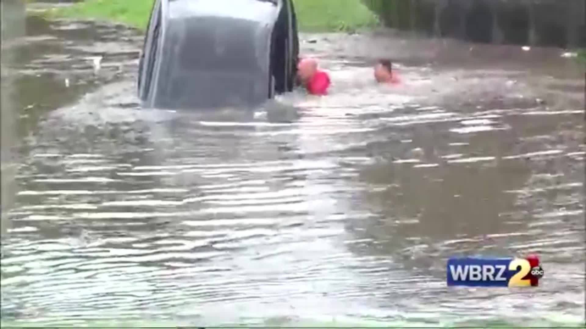 Woman rescued from car in Baton Rouge floods