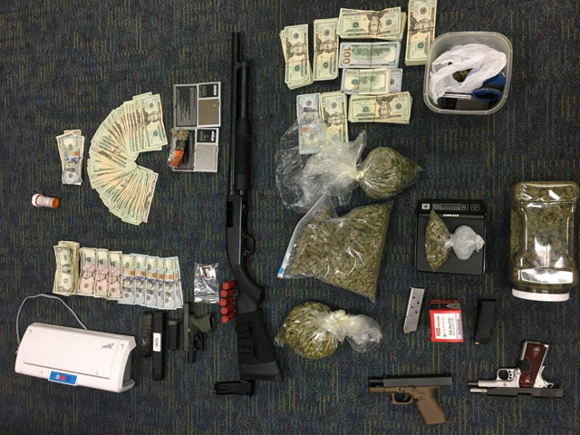 Seized weapons, drugs, and cash_487450