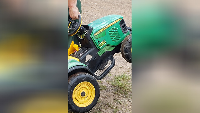 toddler takes tractor to fair