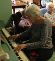 Still sharing her talents at 90, Grandma Kate plays piano for fellow seniors.