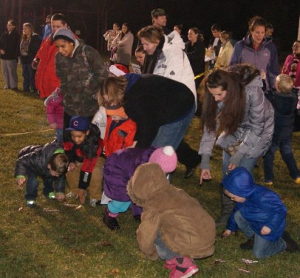 Children hunt for candy at Kentwood's annual tree lighting.