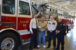 Pictured left to right are Kentwood Fire Chief Brent Looman, James Schaefer, Ph.D., Life EMS Paramedic Paul Pladziewicz II, and Kentwood Police Officer Bill Olenzuk.