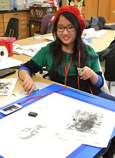 Club member junior Amanda Klassen works on a sketch. She has a piece that has advanced to the Michigan Art Education Association state competition for judging.
