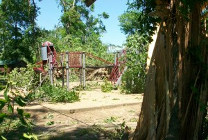 Playground areas within Ideal Park are covered and damaged by fallen trees.