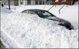 A car in the 900 block of north 4th saw buried after snow plows cleared the road Tuesday and Wednesday. (H-W Photo/Michael Kipley)