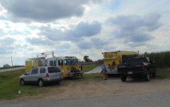 Fire crews remain at the scene of a plane crash just south of the runway at the Starke County Airport