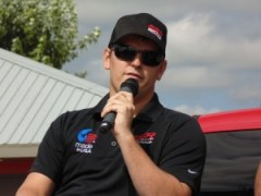 Max Gresham speaks to fans at Eldora Speedway