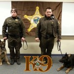 "Deputy Travis Clark with K-9 ""Gil"" (L) and  K-9 Deputy Ryan Austin with K-9 ""Terror"""