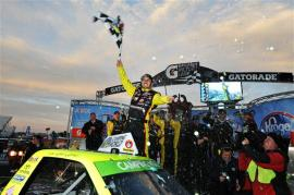 Matt Crafton, driver of the #88 Ideal Doors / Menards Toyota, celebrates in victory lane after winning the NASCAR Camping World Truck Series Kroger 250 at Martinsville Speedway on March 30, 2014 in Martinsville, Virginia. Photo by Rainier Ehrhardt/Getty Images