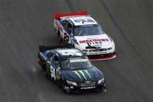 Kyle Busch, driver of the #54 Monster Energy Toyota, leads Brad Keselowski, driver of the #22 Discount Tire Ford, during the NASCAR Nationwide Series Blue Jeans Go Green 200 at Phoenix International Raceway on March 1, 2014 in Avondale, Arizona. Photo by Chris Trotman/Getty Images
